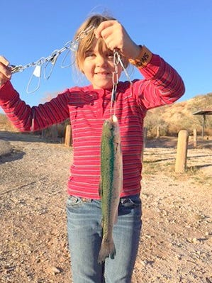 Shera Griffin of Roswell caught this trout on Powerbait on Dec. 4. The eight-year old was fishing at Bottomless Lakes State Park.