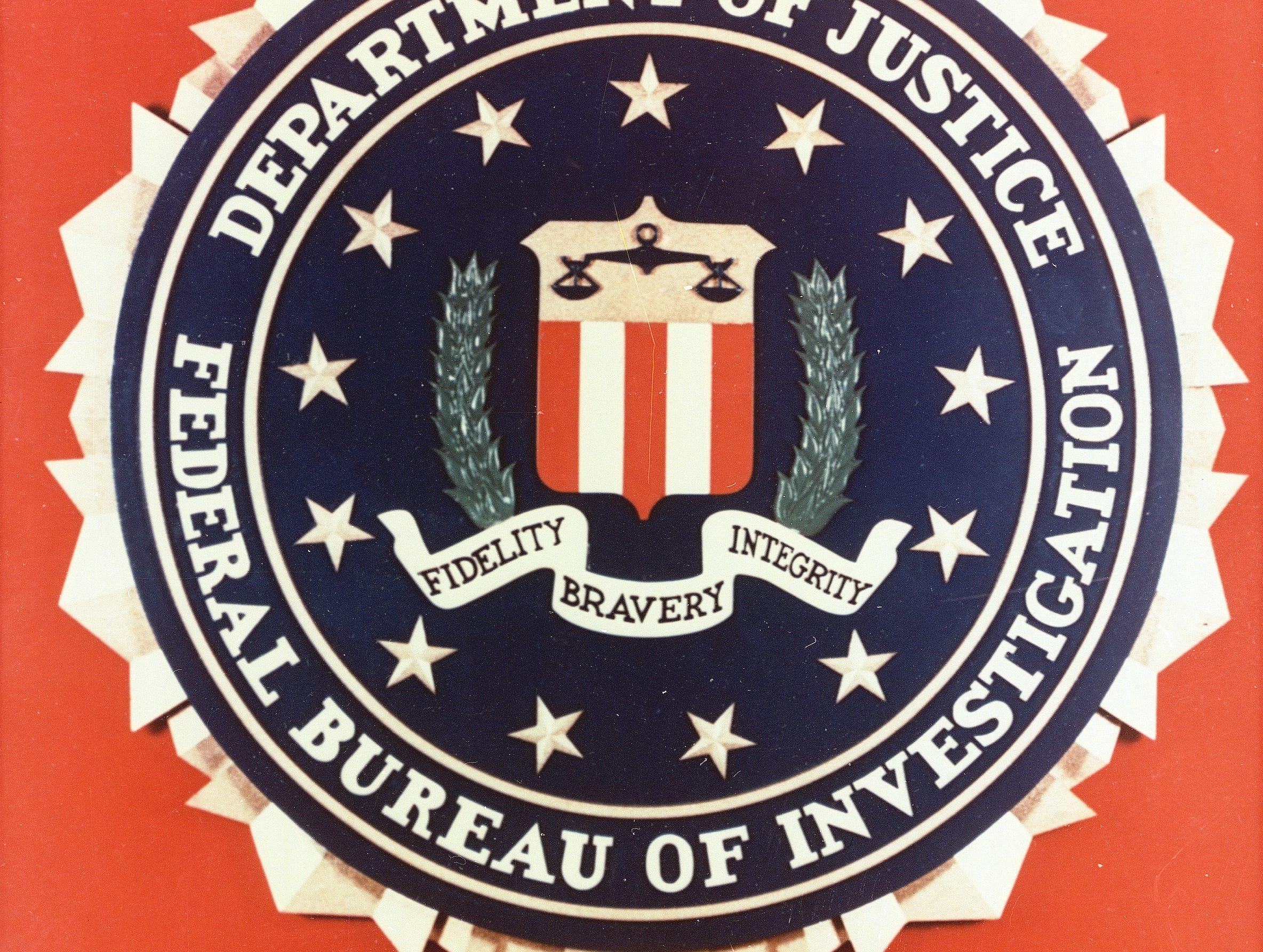 http://www.gannett-cdn.com/-mm-/194cc82590cd0f9626a8649ccfecfa44dc21adc7/c=0-660-2368-2445&r=2368x1785&r=x404&c=534x401/local/-/media/USATODAY/USATODAY/2013/08/07/1375921718000-AP-AXX-FBI-SEAL.jpg