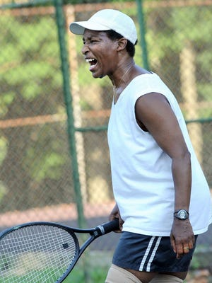 Special Olympian Loretta Claiborne still has a very competitive spirit in her 60s. Here, she shows her frustration while playing a round of outdoor tennis at Farquhar Park.