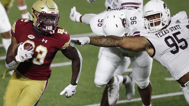 Texas State defensive lineman Nico Ezidore, right, tries to stop Boston College running back Travis Levy during the first half of last Saturday's game in Chestnut Hill. BC welcomes No. 12 UNC  on Saturday.