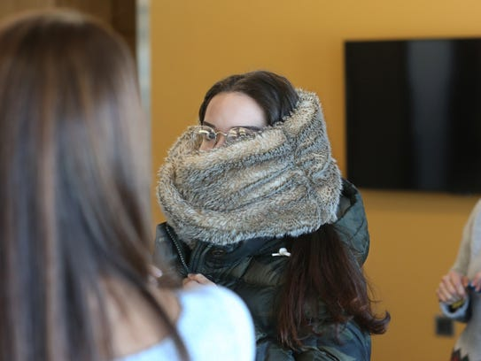 Andrea Rosado, center, bundles up before heading outside, and the cold, for her next class at the University of Rochester on Wednesday, Feb. 14, 2018. A group of seven students are all studying at the university this semester following the devastating hurricane that hit their homes in Puerto Rico.