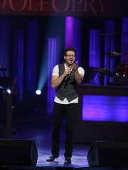 "Danny Gokey, top, performs on the ""Grand Ole Opry"" on July 5."