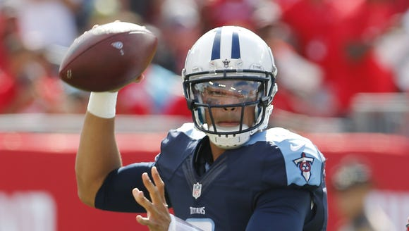 Titans quarterback Marcus Mariota (8) looks to pass