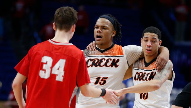 Boyd County's Gunner Short, 34, shakes hands with Fern Creek's Clint Wickliffe, 15, and Ahmad Price, 10, following Fern Creek's 69-67 overtime win during a first round game of the Whitaker Bank/KHSAA Boys' Sweet 16 basketball tournament played at Rupp Arena in Lexington, Ky. Thursday March 15, 2018. (Photo by Gary Landers)