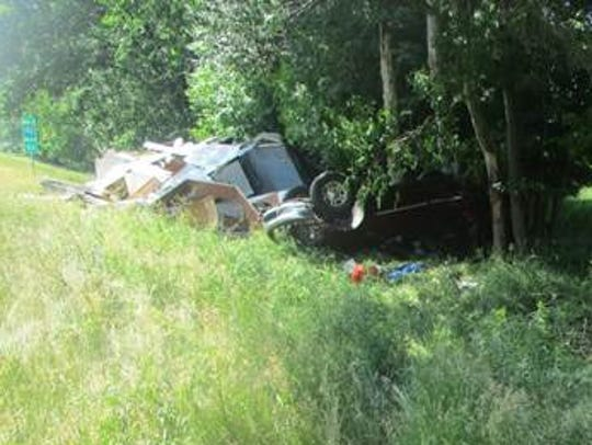 Two people were injured after an SUV towing a camper