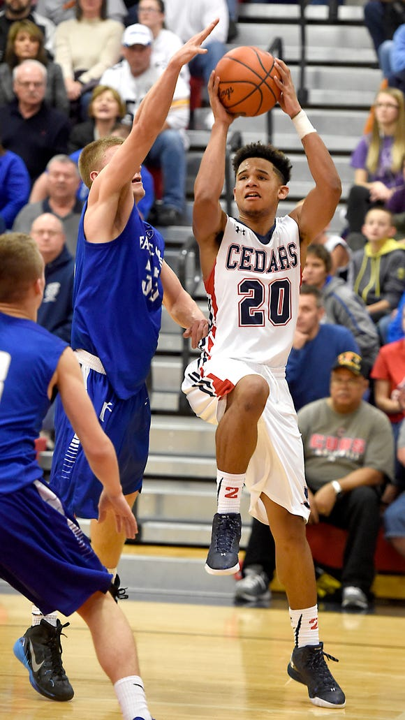 Lebanon's Shaq Ortiz rises up for a shot while being defended by Cedar Crest senior Evan Horn during the Cedars' 44-32 on Friday.