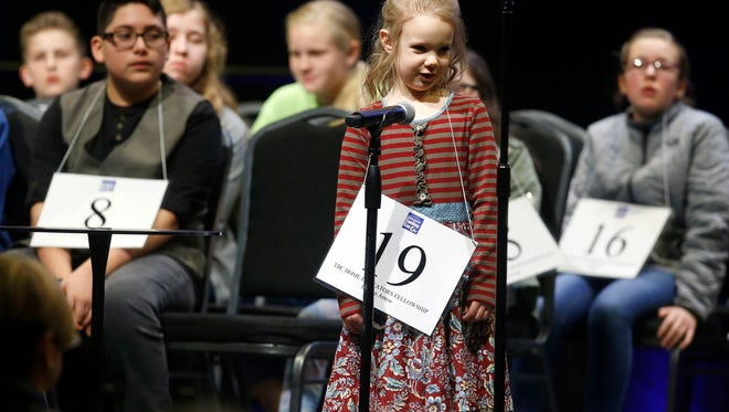 In this March 4, 2017, photo, Edith Fuller, 5, spells a word during the 2017 Scripps Green Country Regional Spelling Bee in Tulsa, Okla. Fuller is bound for the Scripps National Spelling Bee after becoming the youngest winner of a regional competition in Oklahoma. (James Gibbard/Tulsa World via AP)