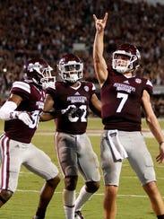 Mississippi State quarterback Nick Fitzgerald (7) celebrates