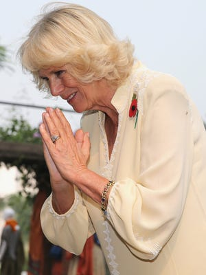 Camilla, Duchess of Cornwall gives a namaste greeting.