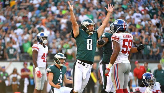 Philadelphia Eagles punter Donnie Jones, arms up,  reacts after 61-yard game-winning by kicker Jake Elliott, second from left, rear,  during the fourth quarter against the New York Giants at Lincoln Financial Field.