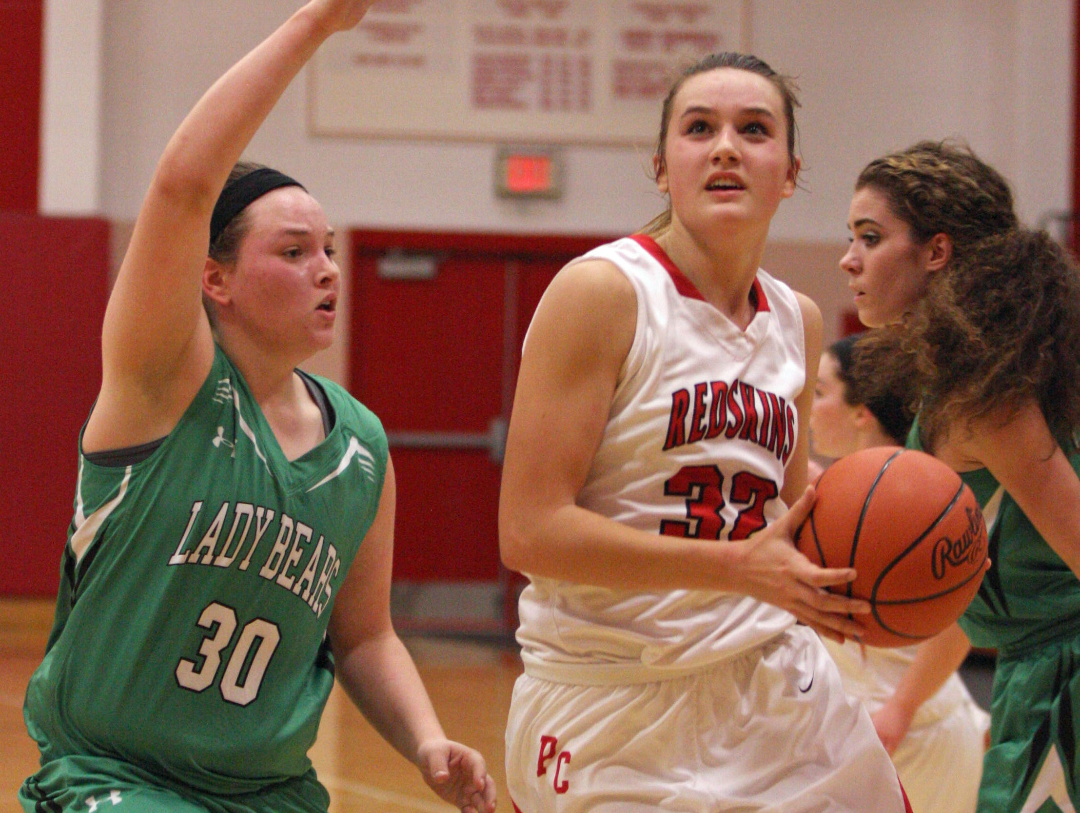 Port Clinton's Sydney Alexander drives to the basket as Margaretta's Paige Black defends Wednesday.