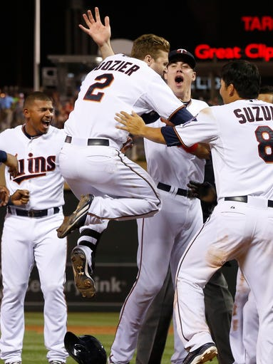 Minnesota Twins' Brian Dozier (2) leaps into the air