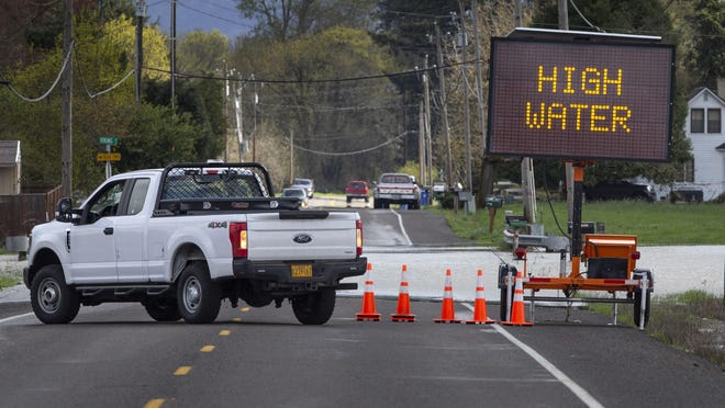 The Oregon Department of Transportation vehicle blocks River Road east north of  Junction City after flood waters spilled over the roadway. [Chris Pietsch/The Register-Guard] - registerguard.com
