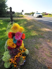 A roadside memorial was set up near the crash site