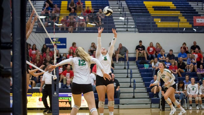 New Castle's Jacie Koontz sets up her team for the attack during game four of the IHSAA Volleyball Sectional on Oct. 14 at Delta High School. New Castle would win the game in overtime 3-2.