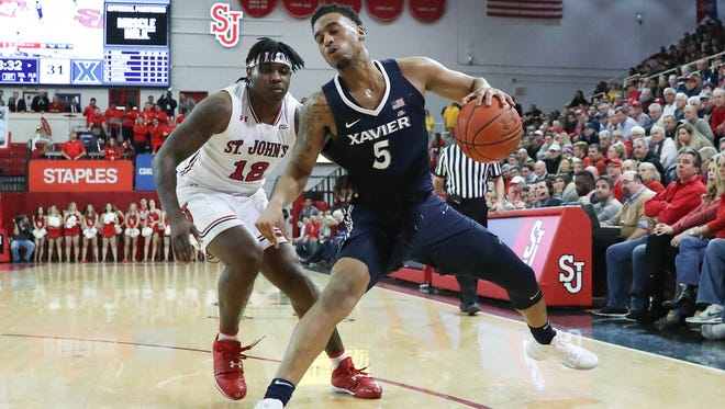 Xavier Musketeers guard Trevon Bluiett (5) works the ball around St. John's Red Storm guard Bryan Trimble Jr. (12) during the first half at Carnesecca Arena.