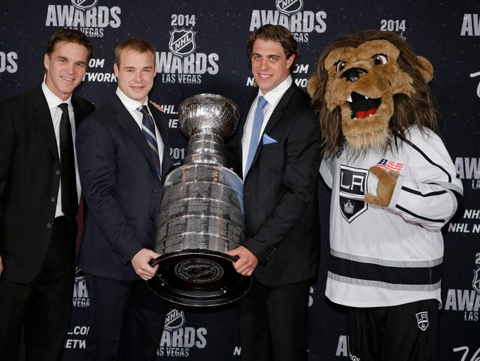 From left, Luc Robitaille, Dustin Brown, and Anze Kopitar and the mascot of the Los Angeles Kings pose with the Stanley Cup on the red carpet before the NHL Awards at the Wynn Las Vegas.