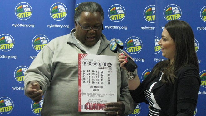 Anthony Sawyer of Mount Vernon, who won  $1 million in the March 8, 2014, Powerball drawing, chats with the Lottery's Magen MacDavid April 18, 2014, at the Lottery's customer service center in Fishkill as he was introduced to the media.