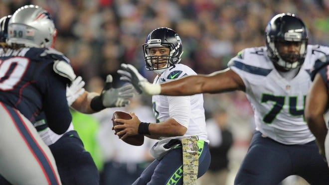 Seahawks quarterback Russell Wilson drops back to pass during a game against the Patriots on Nov. 13, 2016.