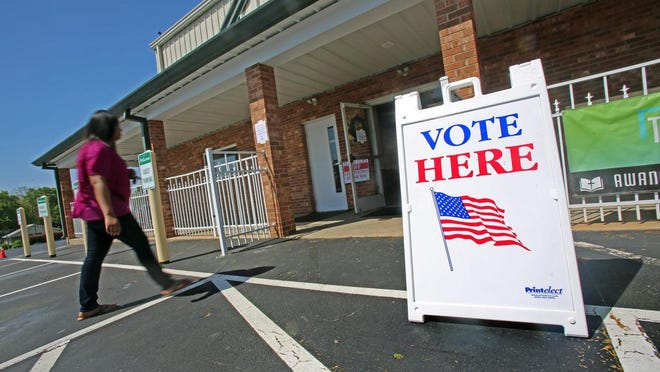 A voter enters the polling station at Bethel Baptist Church in Shelby during a previous election.