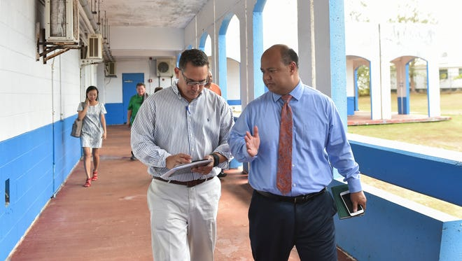 Guam Department of Education Superintendent Jon Fernandez, right, leads a walkthrough facility inspection at F.B. Leon Guerrero Middle School in Yigo on June 6. Inspections of the island's public schools will continue this week and toward the opening of the new school year in August. The inspections are performed to ensure schools are ready for the coming school year.