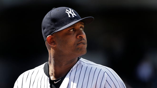 New York Yankees pitcher CC Sabathia looks back at the scoreboard as he walks off the field during the fifth inning of a baseball game against the Colorado Rockies, Wednesday, June 22, 2016, in New York.