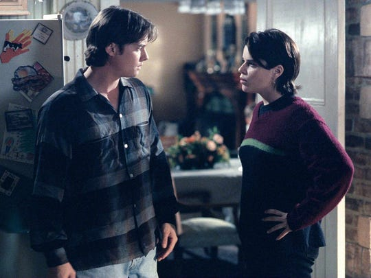 Griffin (Jeremy London, L) and Julia (Neve Campbell,