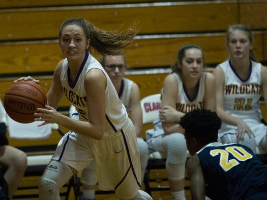 Scotti Harrison, 2, dribbles toward the basket during