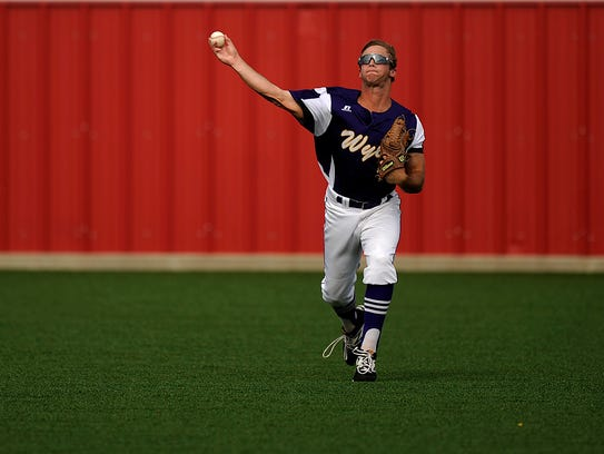 Wylie left fielder Cameron Hanna (29) throws out a