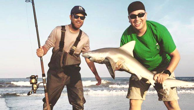 Mike and Bryan with a brown shark caught on July 29. The shark was released safely back into the Brigantine waters. If you are looking for a strong fight and some great action, now is the time to be in Brigantine, NJ.