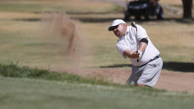 Cody King, a five-time winner of the LakeRidge Stampede, hits out of a bunker during last year's final round. King and Michael Pruitt are defending champions of the tournament, which starts Friday.