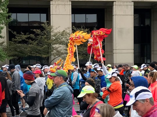 Members of the Indy Chinese Runners Club toted a pair of ornamental dragons on their run across the mini-marathon course.