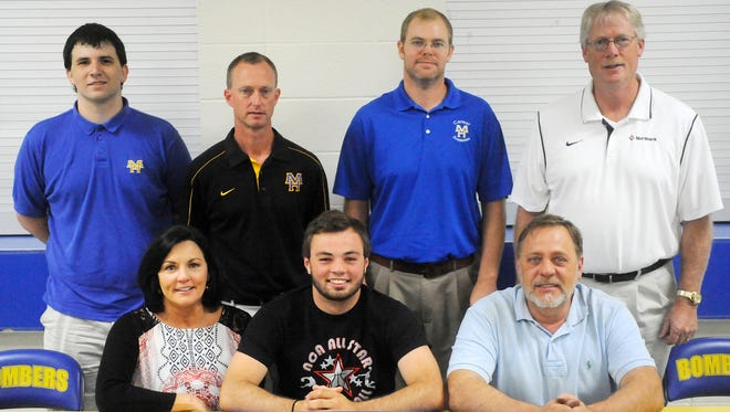 Mountain Home's Preston Groesbeck, first row, middle, signed a National Letter of Intent on Wednesday to play basketball at North Arkansas College in Harrison. Shown with Groesbeck are: front row, from left, his mother, Sheri Groesbeck; his father, Terry Groesbeck; second row, Mountain Home assistant Dylan Connolly; Mountain Home head coach Mitch Huskey; Mountain Home assistant Grant Greenhaw; and North Arkansas head coach Steve Hunter.