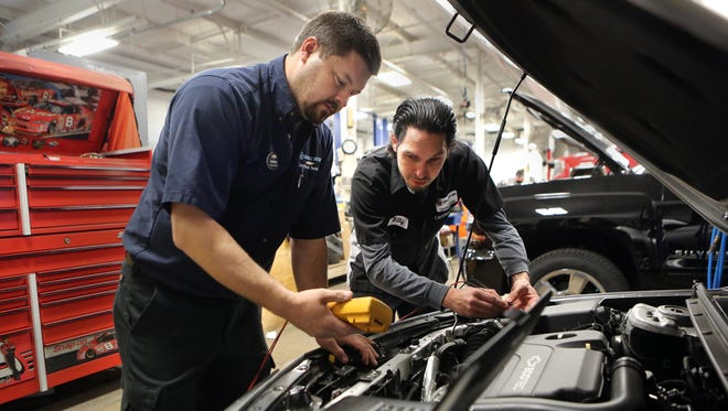 March 14, 2017 - March 14, 2017 - Shop Foreman Derrick Richter (left) and ASE Master Auto Technician Billy Hampton use diagnostic computer technology in the shop at Chuck Hutton Chevrolet. Memphis auto dealers and Moore Tech are setting up a car tech school.