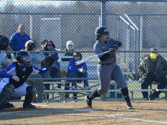 Sussex Tech's Madison Watson hits a homer against Sussex