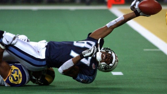 Titan's Kevin Dyson tries to stretch across the goal