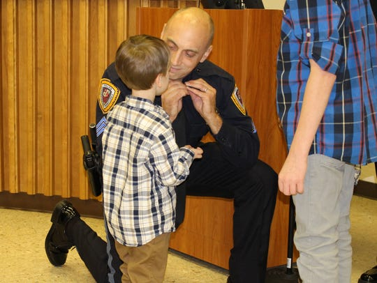 New Corporal Ian Armstrong receives his pin Monday