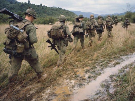 "Soldiers patrol in ""The Vietnam War,"" a 10-part, 18-hour"