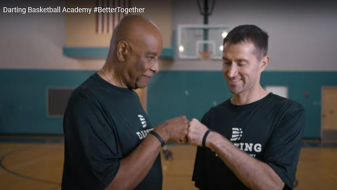 "Former Highland Park principal Dale Cushinberry, left, and Kerry Darting, co-founder and president of the Darting Basketball Academy, are shown in the ""Better Together"" video campaign promoting unity and racial equality."