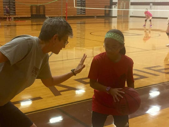 Meg Turner and her daughter, Mia McMurry, play a little 1-on-1 in the gym at Owen High School.