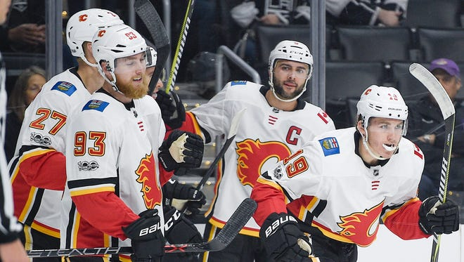 The Calgary Flames celebrate a goal by left wing Matthew Tkachuk (19) against the Los Angeles Kings during the first period at Staples Center.