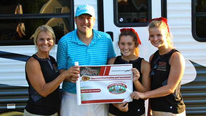 Dan Ebbutt, second from left, hit a hole-in-one during Riverdale cheerleaders' golf tournament on Friday. From left, are cheerleading coach Brooke Wyant, Ebbutt and cheerleaders Regan Smith and Madison Josey.
