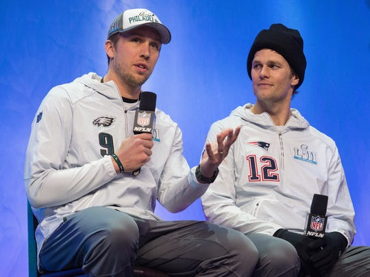 Philadelphia Eagles quarterback Nick Foles, 9, responds