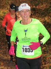 Theresa Connors runs in the Rosaryville Veterans Day