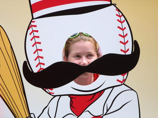Megan Phillips, of West Carrollton, poses as Mr. Redlegs, during the MLB All-Star Summer Pepsi Block Party at The Banks, on Sunday, July 12.