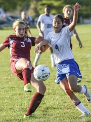 Highland Park's Katie Volpert (3) and Timothy Christian's Rayza Michelen (4) in action in Piscataway on Oct. 5, 2016.