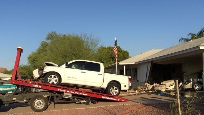 One person was injured when a truck ran into a Scottsdale house on April 22, 2015.