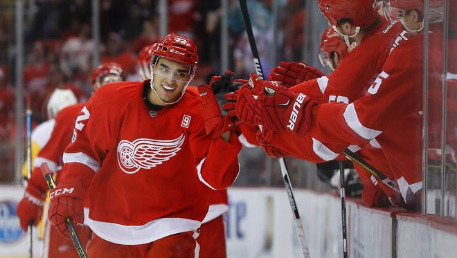 Red Wings center Andreas Athanasiou (72) celebrates his goal in the third period of the Wings' 6-3 win over the Penguins Saturday at Joe Louis Arena.