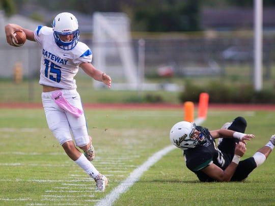 Gateway Charter quarterback Tyious Savoy stays inbounds, evading St. John Neumann defense at St. John Neumann High School in Naples on Tuesday, Oct. 24, 2017.