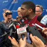 Montreal Alouettes defensive lineman Michael Sam speaks to reporters after returning to practice with the Canadian Football League team Monday, June 29, 2015, in Montreal. Sam, the first openly gay player drafted by an NFL team,  could not make the roster of the St. Louis Rams and signed with Montreal. He left the Alouettes for what he said were personal reasons, but returned to the team this week. (AP Photo/Jimmy Golen)